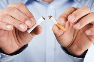 Changing Patient Behavior: Identifying and Addressing Barriers   Man Breaking Cigarette in Half