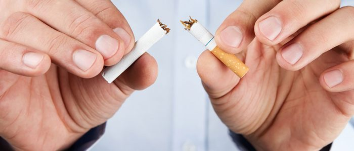 Changing Patient Behavior: Identifying and Addressing Barriers | Man Breaking Cigarette in Half