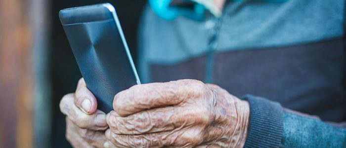 COVID-19 Pre-screening | Elderly Man Reading Messages on Smartphone