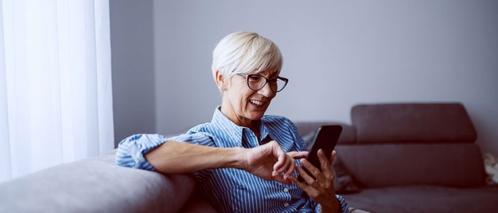 ePROs: What are Electronic Patient Reported Outcomes? Woman on Smartphone