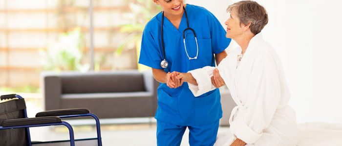 Reducing Hospital Readmissions: 5 Strategies | Nurse Helping Patient Out of Bed